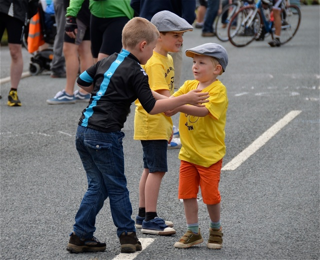 "Three ""young tykes"" get excited as the riders approach..........."