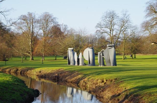 Metallic sculptures alongside the brook