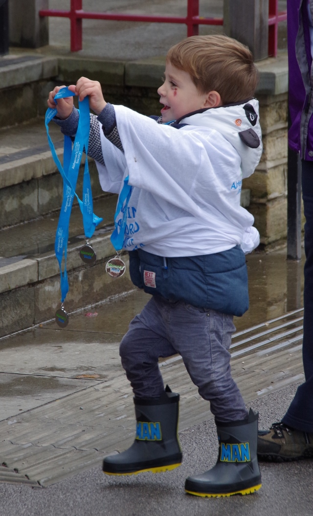 Young mans delight at getting his medal